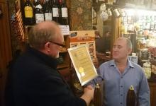 CAMRA Durham chairman Peter Lawson presenting landlord Michael Webster with certificate